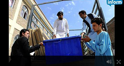 Afghans vote in presidential runoff